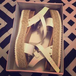 White healed sandals